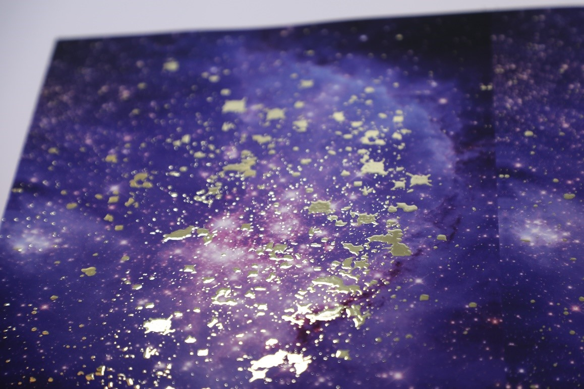 Silver foiling used to create a galaxy print effect on a poster