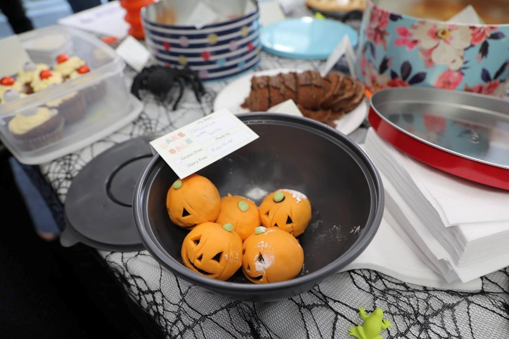 pumpkin treats in a Halloween bake sale