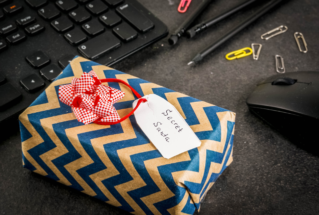 secrete santa gift with stiped wrapping