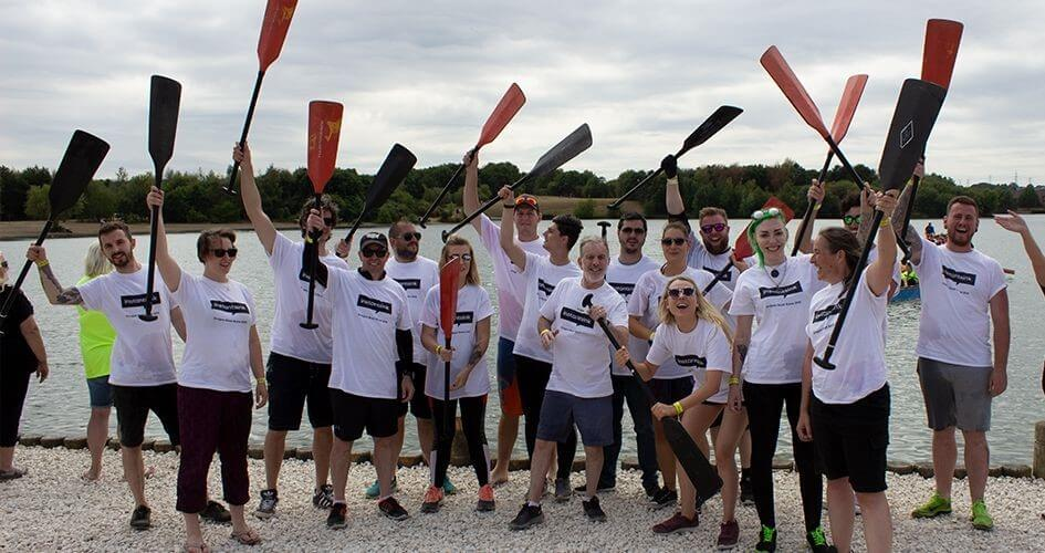 team instantsink hold their oars in the air in celebration