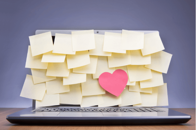 post it notes and a heart on a laptop