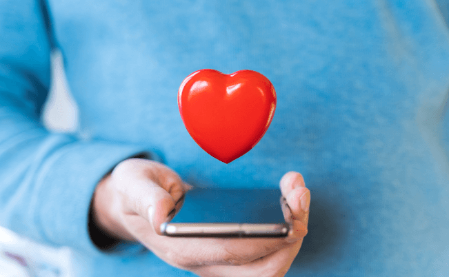 red heart coming out of a mobile phone