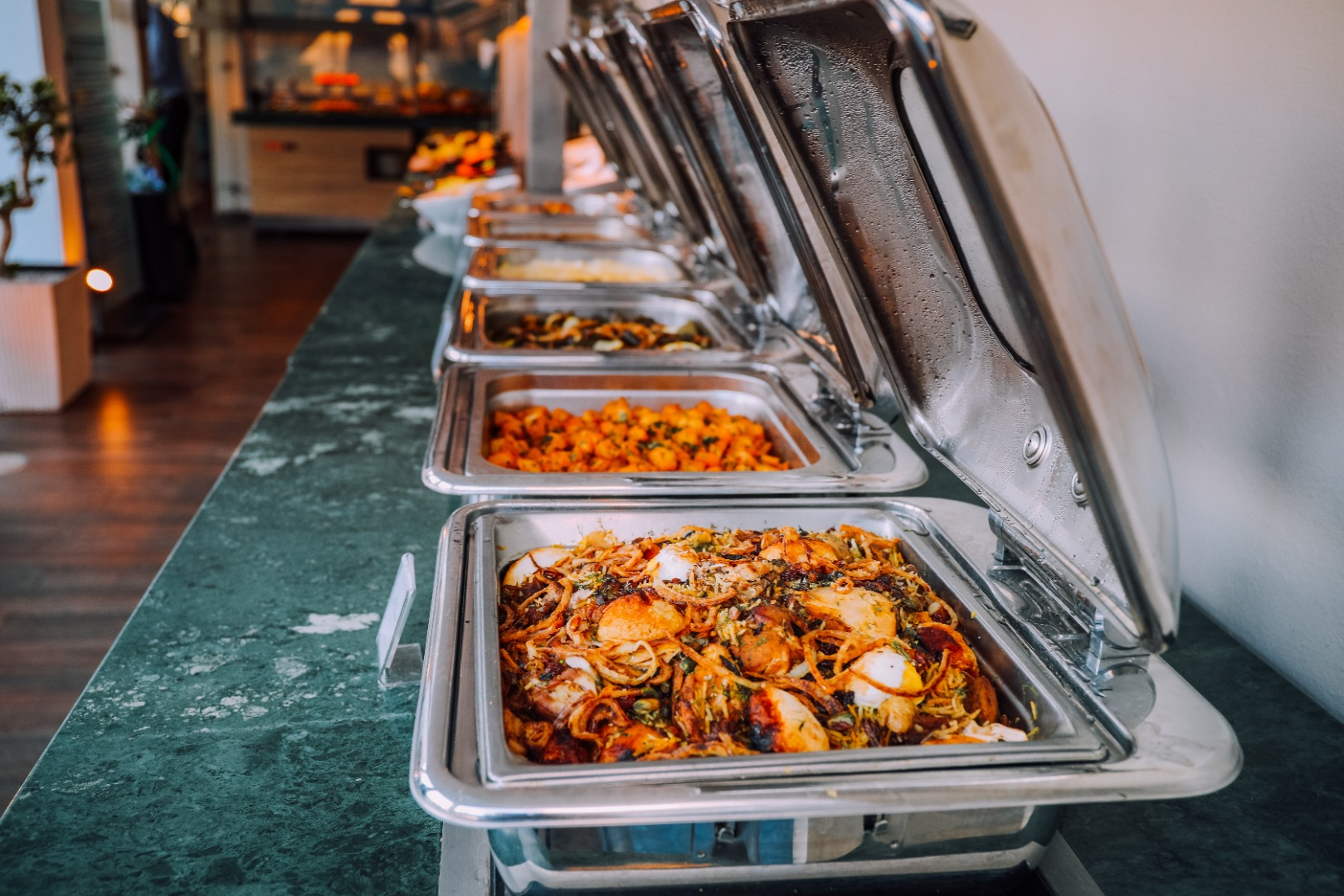 metal containers of food from catering company