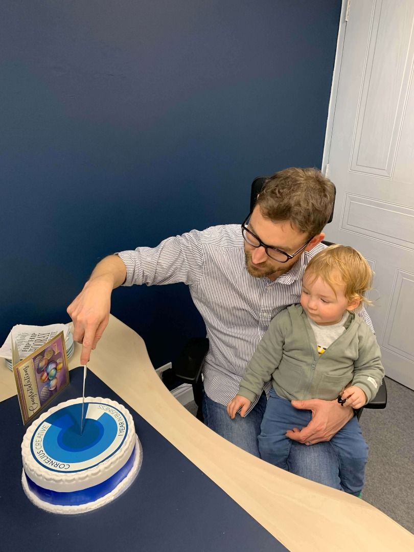Simon and son Leo celebrating a year of business with cake