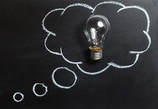 white chalk lightbulb on a blackboard