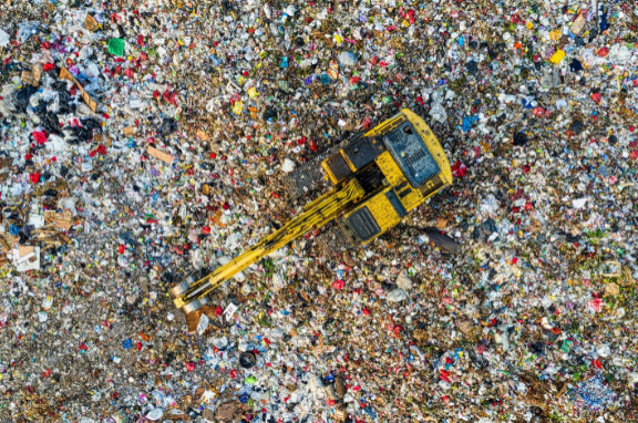 A pile of e-waste with a crane