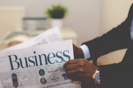 business man holding a newspaper